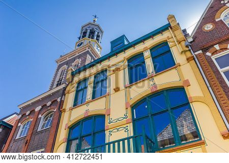 Colorful Old Houses In Front Of The Tower Of Kampen, Netherlands