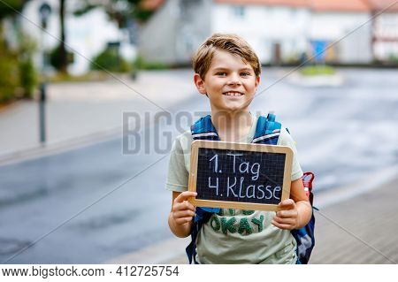 Happy Little Kid Boy With Backpack Or Satchel. Schoolkid On The Way To Middle Or High School. Child