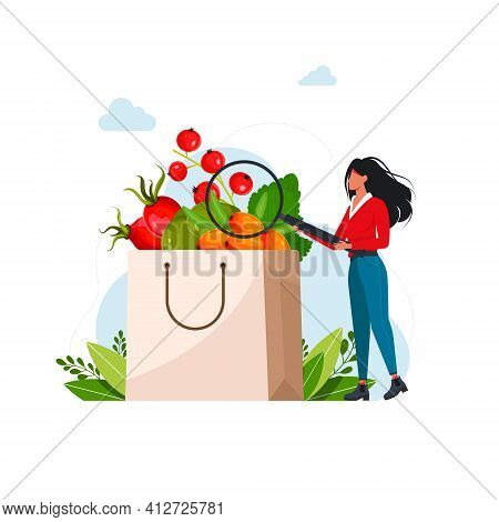 Woman Examines In A Magnifying Glass Berries Rich In Vitamin C Paper Bag With Fresh Fruit Berries. V