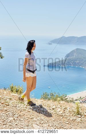 Woman Walks Along The Lycian Way Trail. Fethiye, Oludeniz. Beautiful View Of The Sea And The Beach.