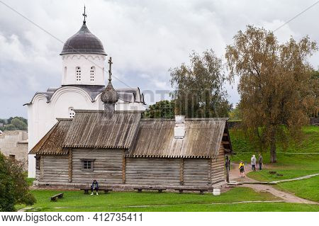 Staraya Ladoga, Russia - September 6, 2020: Ordinary People Are Near The Wooden Chapel And St. Georg