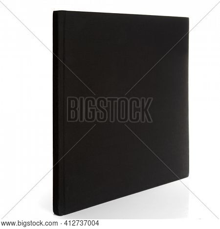 Square hardcover black book isolated on white background, copy space