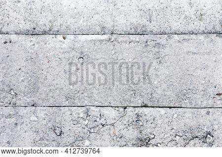 Concrete Blocks Background. Gray Horizontal Stripes. Concrete Fence Block Wall. Grunge Urban Texture