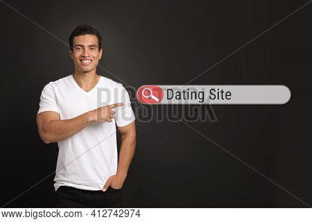 Young African-american Man Pointing At Search Bar With Request Online Dating On Black Background