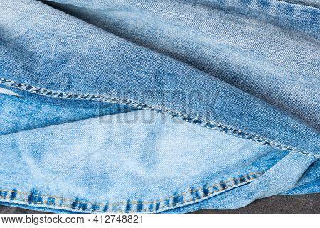 Blue Jeans Close Up. Several Denim Pieces Of Blue Pants. Jeans Texture. Jeans Background.
