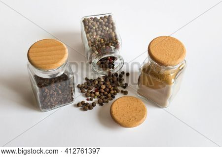 Mockup Template With Three Jars Glass Hermetic Bottles With Wooden Caps And Spices Herbs Black Peppe