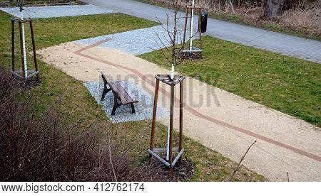 Newly Introduced Park Beige Gravel Walkways, Metal Rusty Corten Steel Design Strips In The Road Surf
