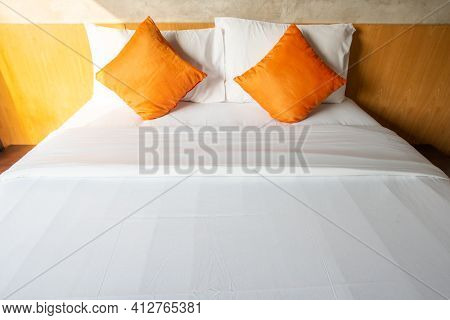 View Of Comfortable Double Bed In Bedroom Decoration In Cozy Style. Conceptual Of A Room In A Home W