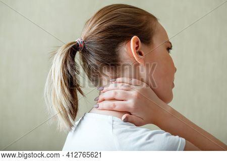 Neck Shoulder Pain, Cervical Vertebrae. Woman Holds Neck With Pain Cervical Muscle Spasm By Hand. Di