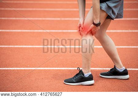 Close Up Of Runner Woman Holding Her Leg, Suffuring From Itb Syndrome Caused By Altered Running Biom
