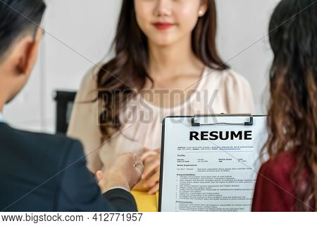 Closeup Resume In Two Manager Hand Holding When Discuss About Her Resume With Happiness Motion Over