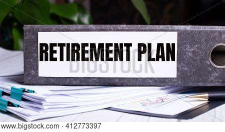 The Words Retirement Plan Is Written On A Gray File Folder Next To Documents. Business Concept