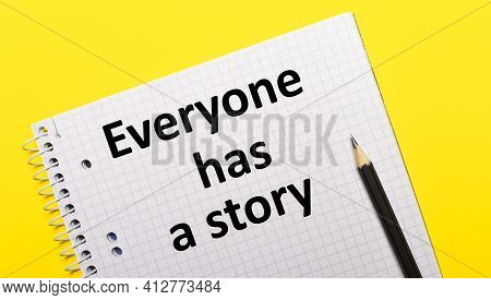White Notebook With Inscription Everyone Has A Story Written In Black Pencil On A Bright Yellow Back