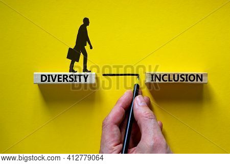 Diversity, Inclusion Symbol. Wooden Blocks With Words 'diversity, Inclusion' On Beautiful Yellow Bac