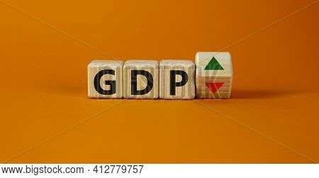 Gdp, Gross Domestic Product Symbol. Wooden Cubes With Up And Down Icon. Word 'gdp'. Beautiful Orange