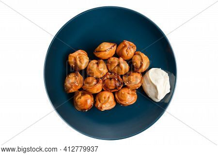 Chinese Cuisine Traditional Fried Dumpling Jiaozi With White Sour Cream Sauce On Blue Dish On White
