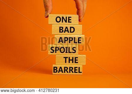 One Bad Apple Spoils The Barrel Symbol. Wooden Blocks With Words 'one Bad Apple Spoils The Barrel'.