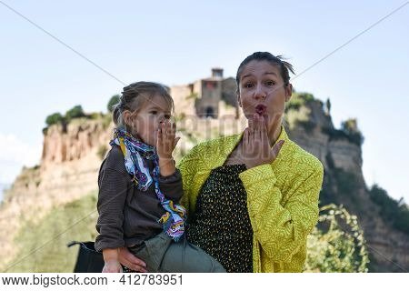 Stylish Mom And Daughter Having Fun Together - Cute Preschool Girl And Her Young Mother Looking At C