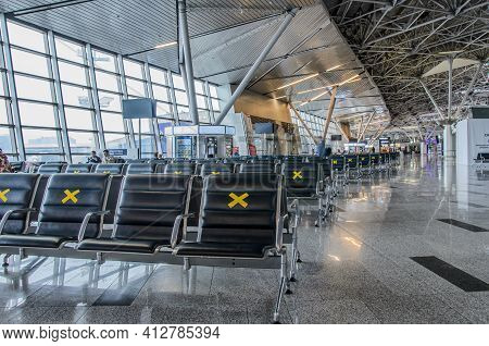 Moscow, Russia: 03.15.2021 - Vnukovo International Airport, Departure Area. Labeled Waiting Chairs F