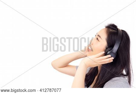 Beauty Asian Woman Listening Music In Headphones And Singing Song With Isolated On White Background