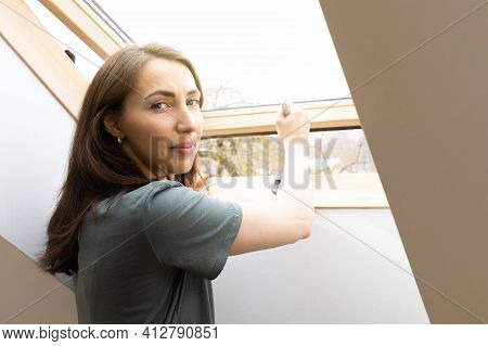 Women Opening A Window At Home Office And Letting Fresh Air In. Healthy Working Environment In New N