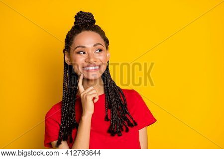 Portrait Of Pretty Smart Minded Cheerful Girl Looking Aside Copy Space Deciding Isolated Over Bright