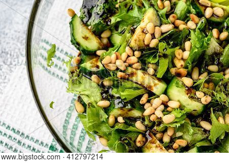Healthy Food Concept: Green Salad With Cucumbers, Mint, Pine Nuts And Balsamic. Selective Focus. Org