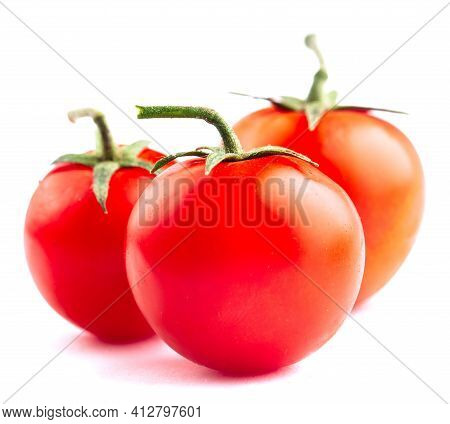 Cherry Tomatoes Isolated On White. High Quality Photo.
