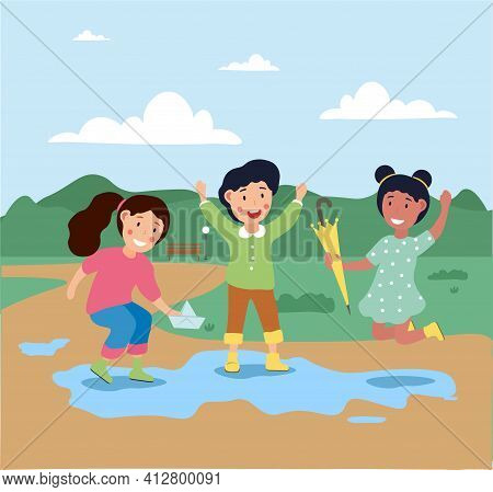 Little Cute Children Are Playing Outside Under The Rain Together. Happy Smiling Girls Are Having Fun
