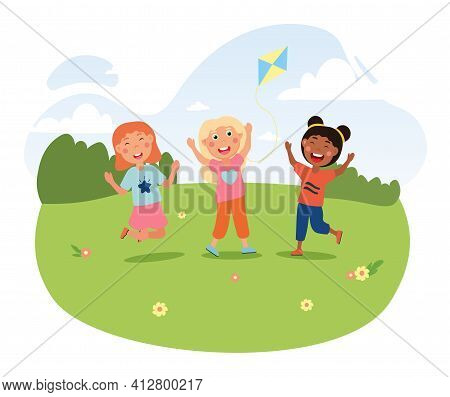 Three Cute Litte Girls Are Jumping On Summer Meadow With Kite. Happy Smiling Children Spending Time