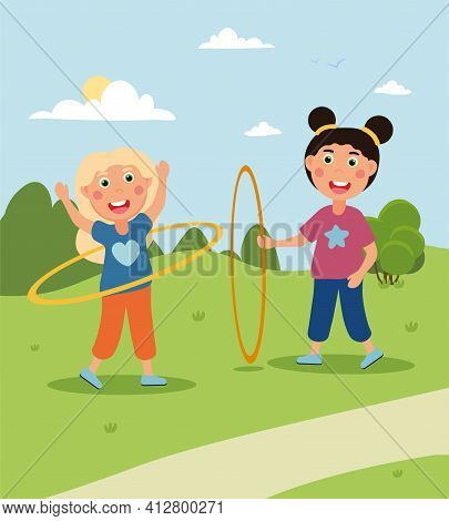 Two Little Cute Girls Are Wirling Colored Huha Hoops Together. Happy Children Are Having Fun Togethe