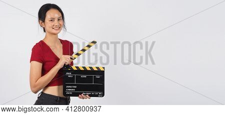 Woman Hand's Holding Black Clapper Board Or Movie Slate Or Slate ,use In Video Production ,film, Cin