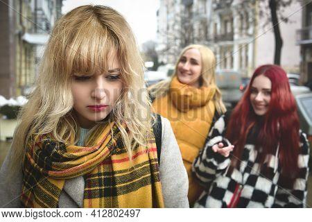 A Young Depressed Student Girl Who Is Bullied By Her Teenage Peers, Disturbed By Feelings Of Despair