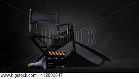 Black Director Chair And Clapper Board Or Movie Clapperboard With Megaphone On Black Background.use