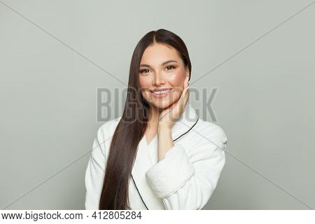 Healthy Spa Woman With Clear Skin And Dark Long Straight Hair On White Background. Young Female Mode