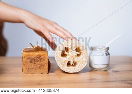 Female Hand , Fibrous Sponge - Luffa, Natural Laundry Soap And Baking Soda In Glass Jar. Non-toxic H
