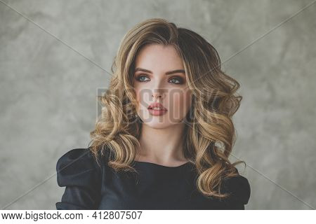 Perfect Woman With Curly Hair On Gray Background Portrait