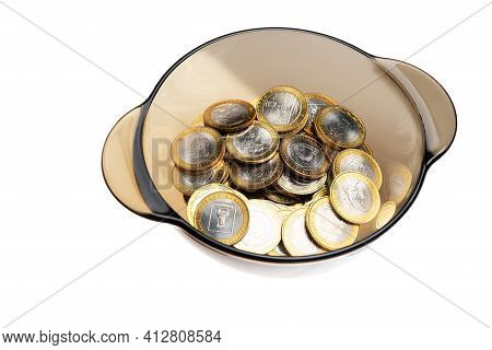 A Handful Of Commemorative Coins. On A White Background