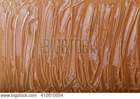 Clear Watery Gel Texture Of Cosmetic Moisturizing Product On Color Brown Background. Hyaluronic Acid
