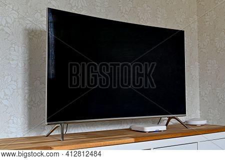 Black Tv Standing On Wooden Bench In Livingroom