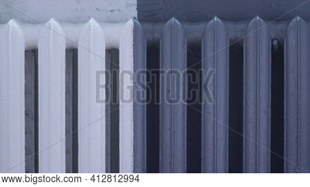 Old Room Heating Radiator Painted Half White, Half Gray, Design Solution For The Color Scheme Of The