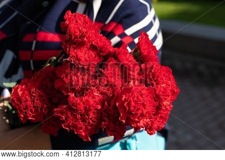 Concept Of May 9 Russian Holiday Victory Day. Bouquet Of Red Carnations Isolated On White Background