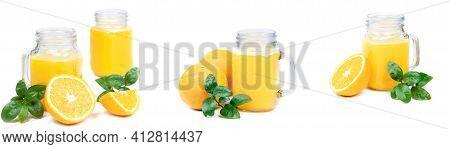 Banner Orange Fruit. Orange Juice Isolated On A White Background. Two Glasses Of Orange Juice. Healt