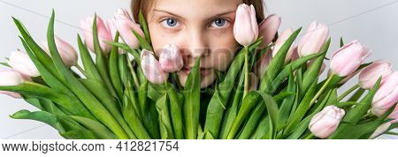 Banner With Little Beautiful Girl Holding Bunch Of Pink Tulips In Hands. Bouquet, Congratulations To