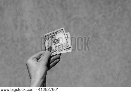 Hand Holding Showing Dollars Money And Giving Or Receiving Money Like Tips, Salary. 100 Usd Banknote