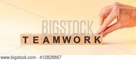 Woman Made Word Teamwork With Wood Blocks
