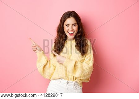 Confident Happy Woman With Curly Hairdo, Pointing Fingers Aside, Showing Promo On Left Copyspace, Sm