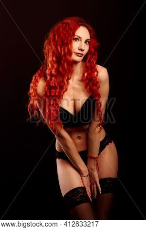 Portrait Of A Beautiful Young Woman With Elegant Long Red Shiny Hair, Hairstyle