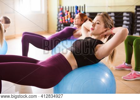 A Group Of Young Women Go In For Sports On Fitness Balls.