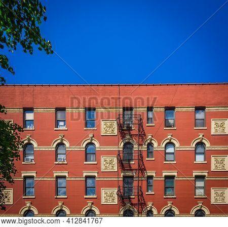 New York City, Usa, May 2019, View Of A Red Brick Buildings With Fire Escape In The Chelsea Neighbor
